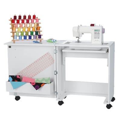 Judy Sewing Cabinet (101) from Arrow Sewing Furniture with sewing machine in flat bed position