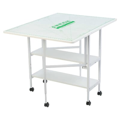 White Dixie Cutting Table (3401) from Arrow Sewing Furniture opened with MAT-C Cutting Mat