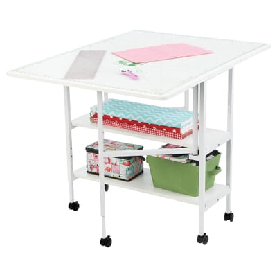White Dixie Cutting Table (3401) from Arrow Sewing Furniture opened with MAT-C Cutting Mat and sewing accessories
