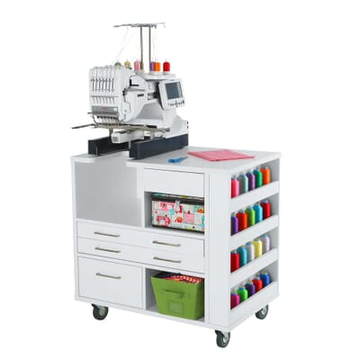 White Ava Embroidery Cabinet (9301J) from Kangaroo Sewing Furniture with embroidery machine and colorful accessories