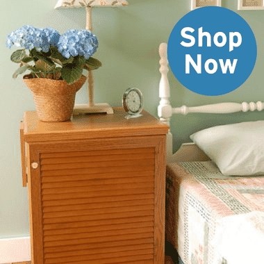 Oak sewing cabinet being used as a nightstand